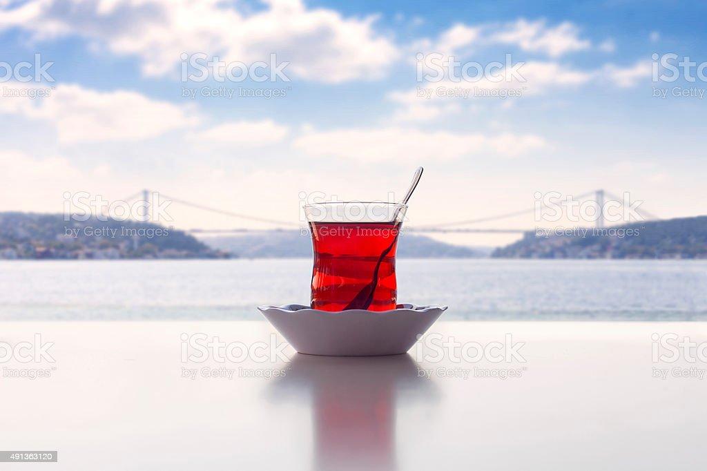 Turkish tea with bosphorus bridge view in Istanbul stock photo