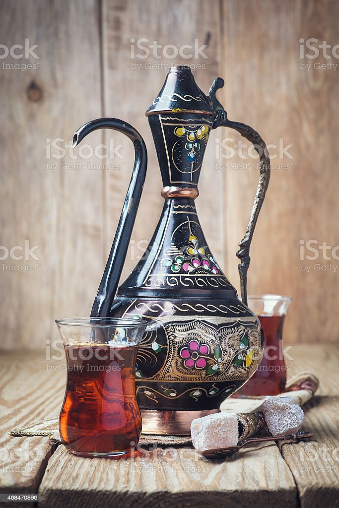 Turkish tea with oriental sweets on a wooden table stock photo