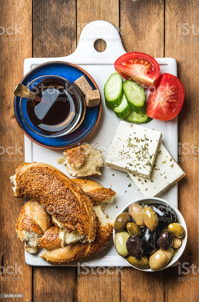 Turkish traditional breakfast with feta cheese, vegetables, olives, simit bagel stock photo