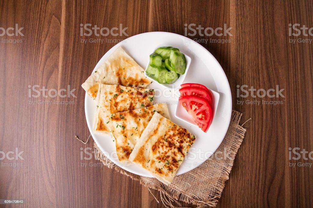Turkish traditional Gozleme pita potatoes with cucumber stock photo