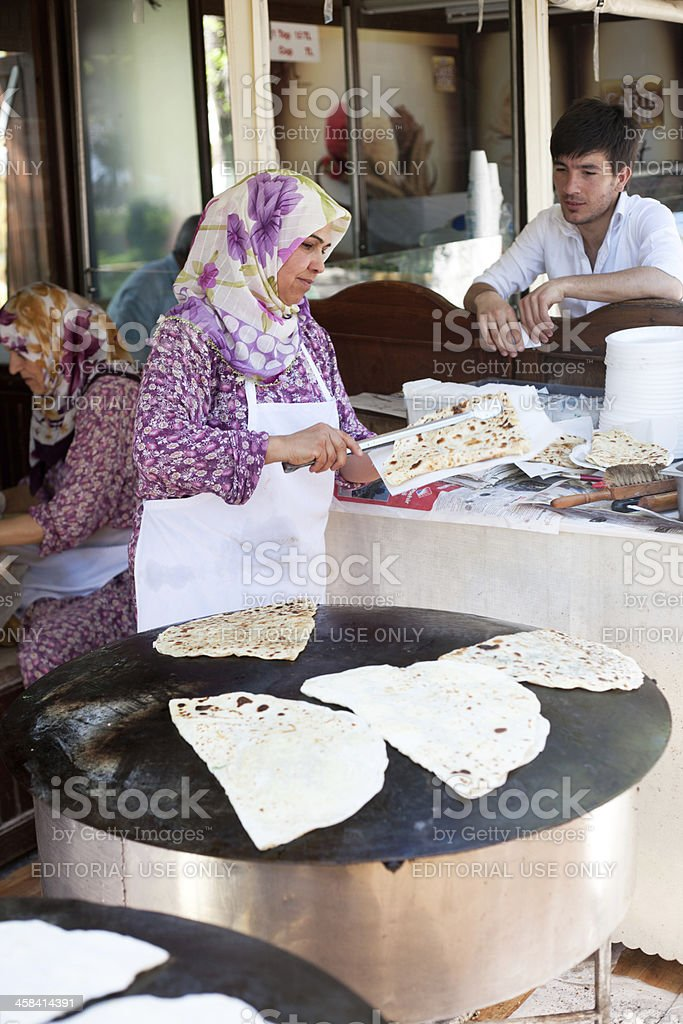 Turkish woman cooking spinach and cheese gozleme stock photo