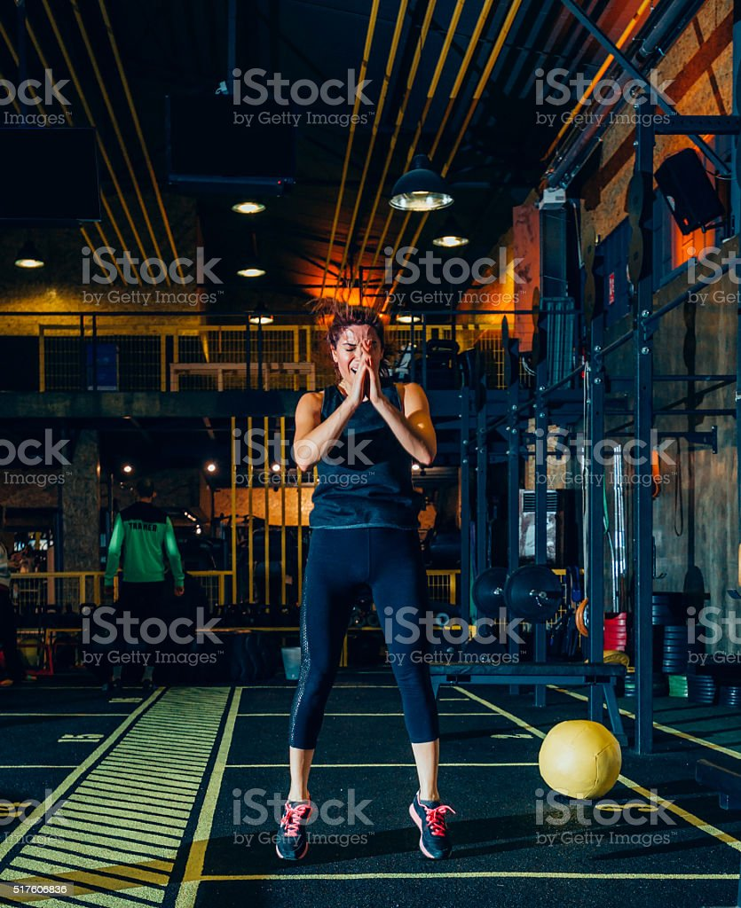 Turkish woman doing a jump exercise at gym stock photo