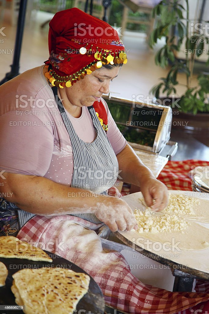 Turkish woman making g?zleme. stock photo