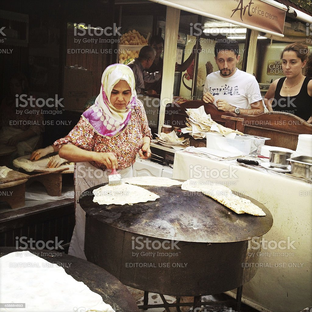 turkish woman preparing flat bread royalty-free stock photo