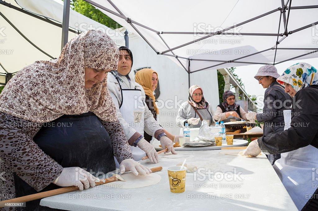Turkish women preparing pies stock photo