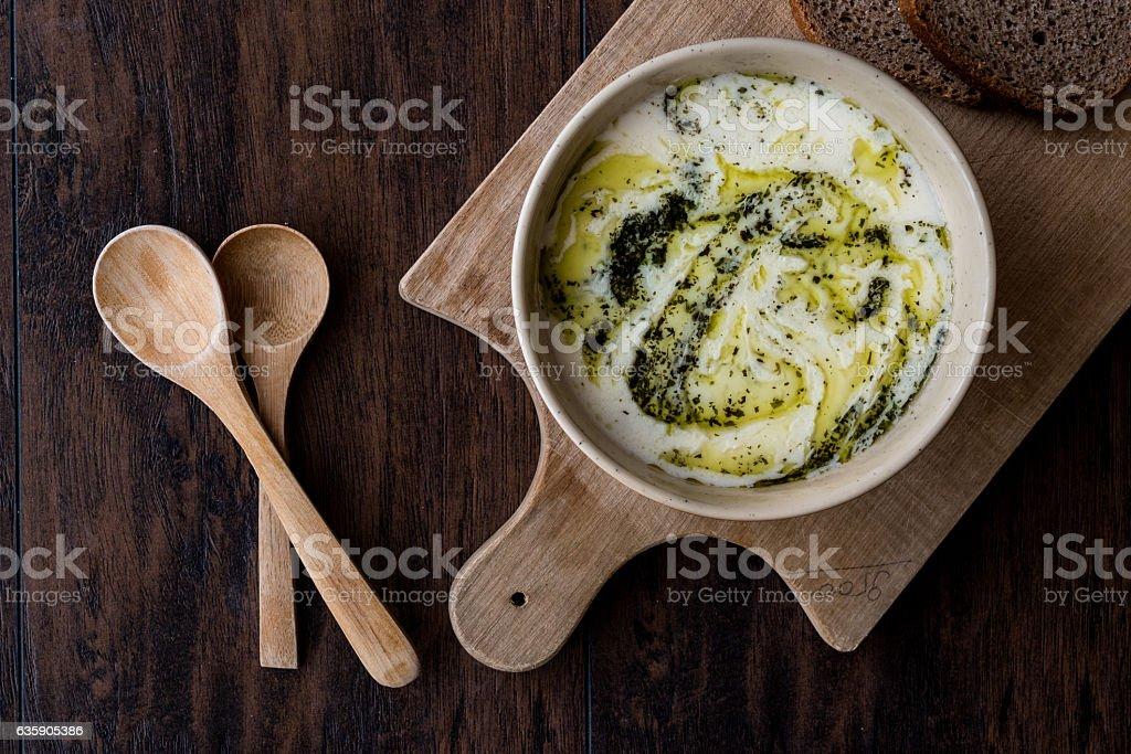 Turkish Yayla or Yogurt Soup with mint sauce (Tzatziki) stock photo