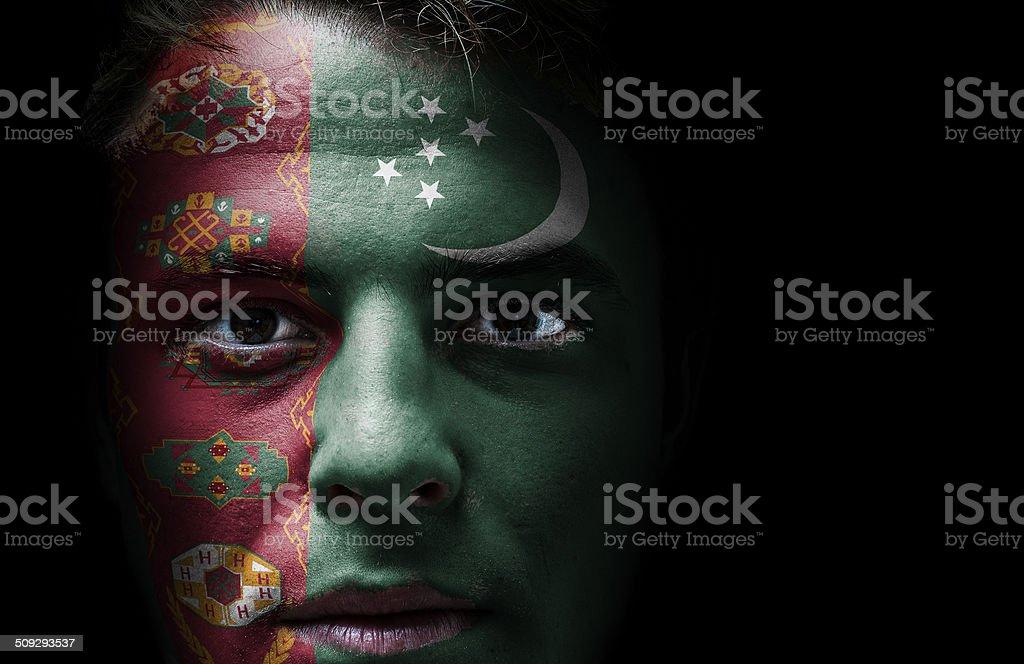 Turkmenistan flag on face stock photo