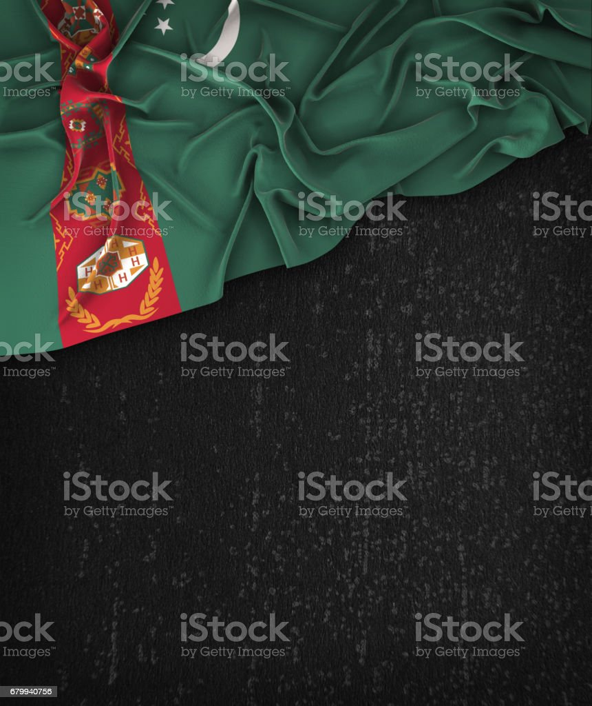 Turkmenistan Flag Vintage on a Grunge Black Chalkboard With Space For Text stock photo