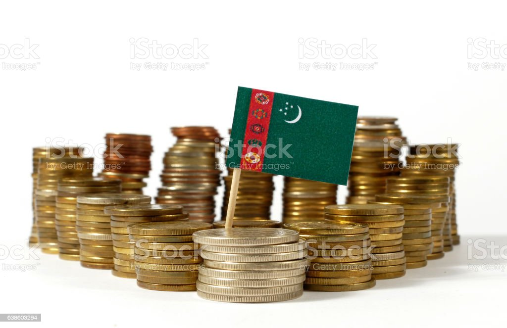 Turkmenistan flag waving with stack of money coins stock photo