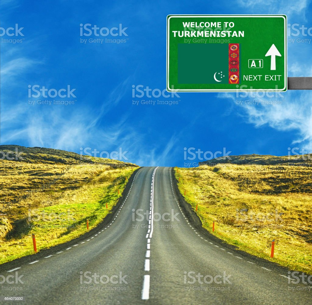 Turkmenistan road sign against clear blue sky stock photo