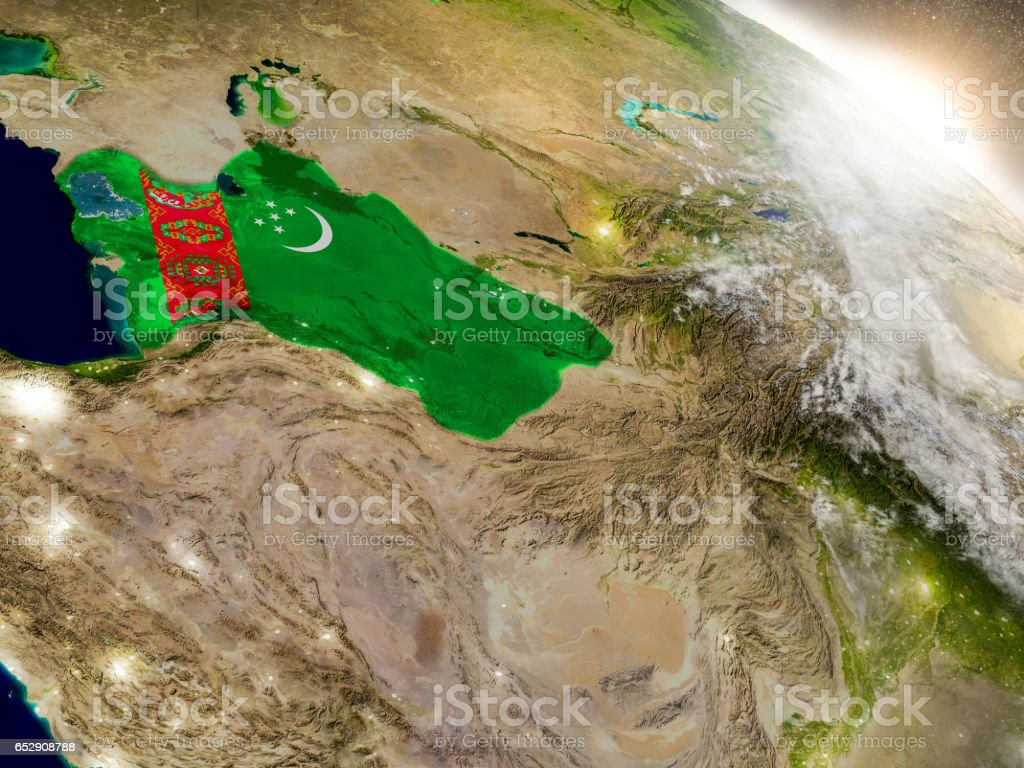 Turkmenistan with flag in rising sun stock photo