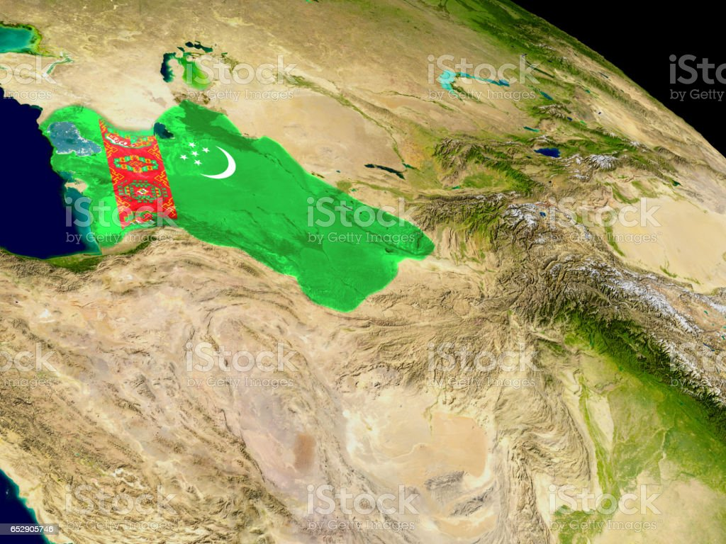 Turkmenistan with flag on Earth stock photo