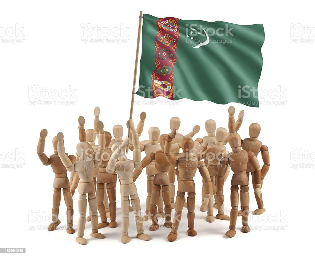 Turkmenistan - wooden mannequin group with flag stock photo