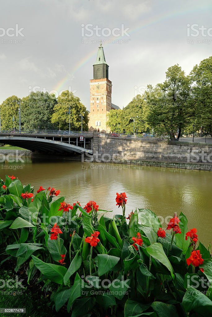 Turku Cathedral with rainbow and flowers stock photo