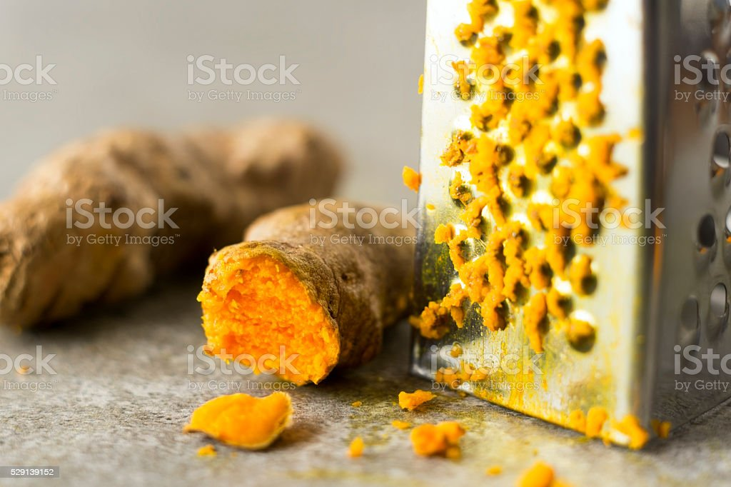 Turmeric and grater stock photo