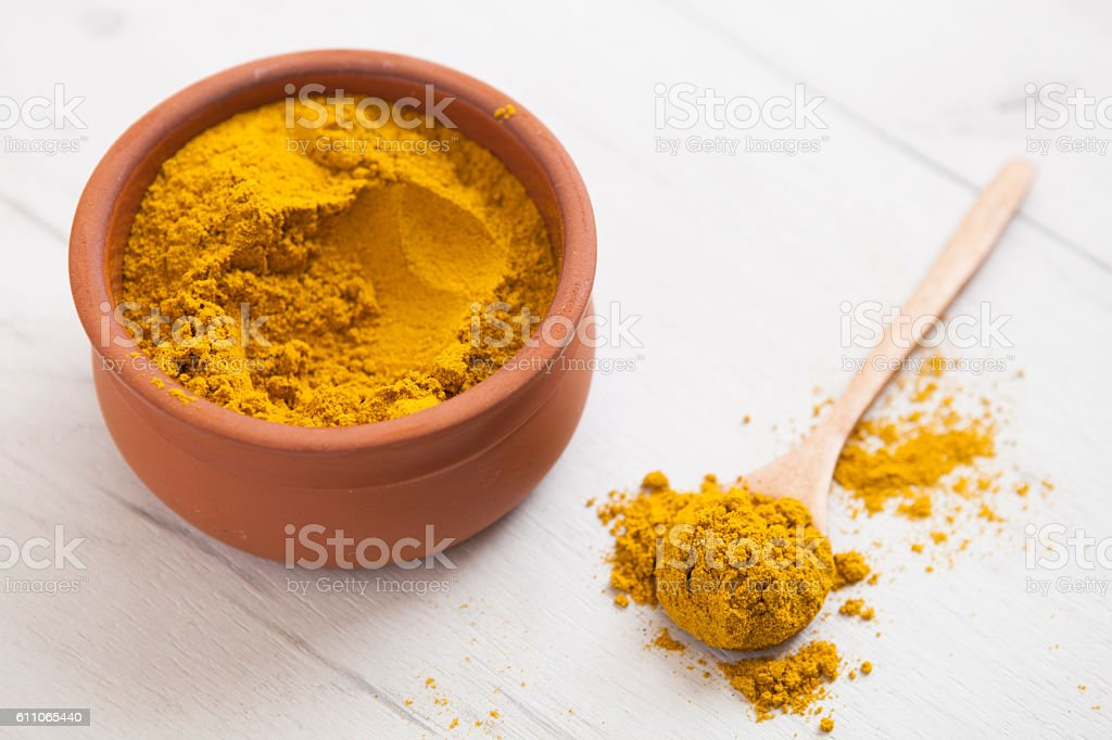 Turmeric in a bowl stock photo