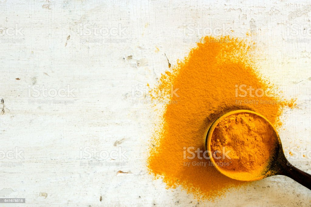 Turmeric Powder Background stock photo