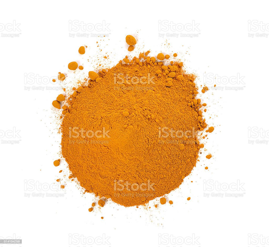 turmeric powder isolated on white background. stock photo