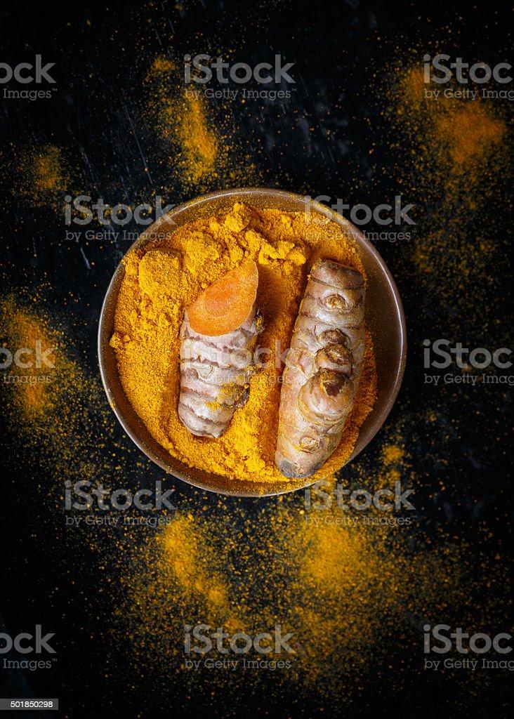 Turmeric roots and turmeric powder stock photo