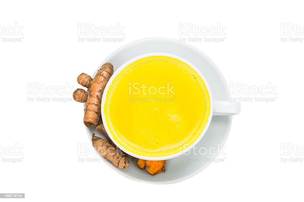 Turmeric roots with milk and honey for beauty and health. stock photo
