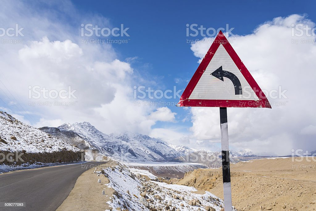 turn left sign mountain road stock photo