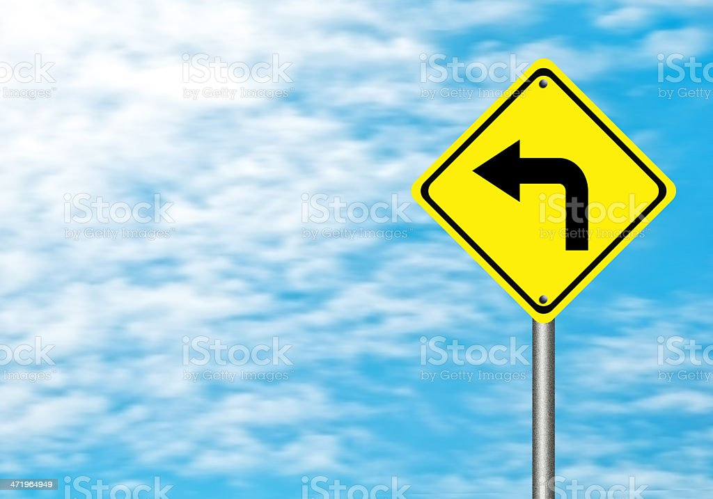 Turn left yellow traffic sign stock photo