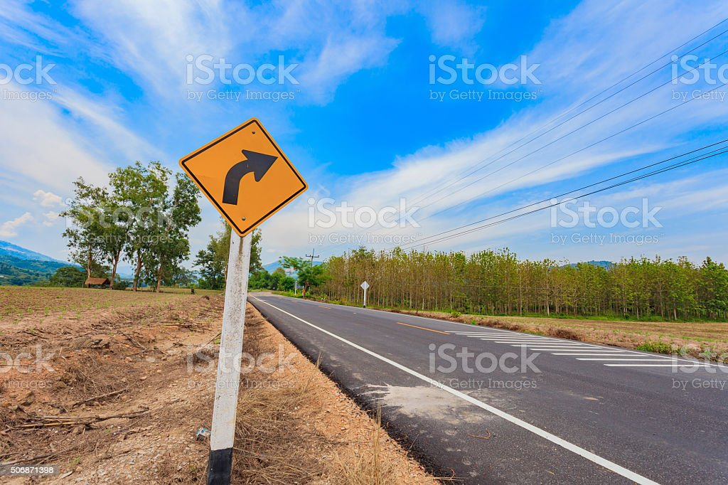 Turn right road sign in the rural area stock photo
