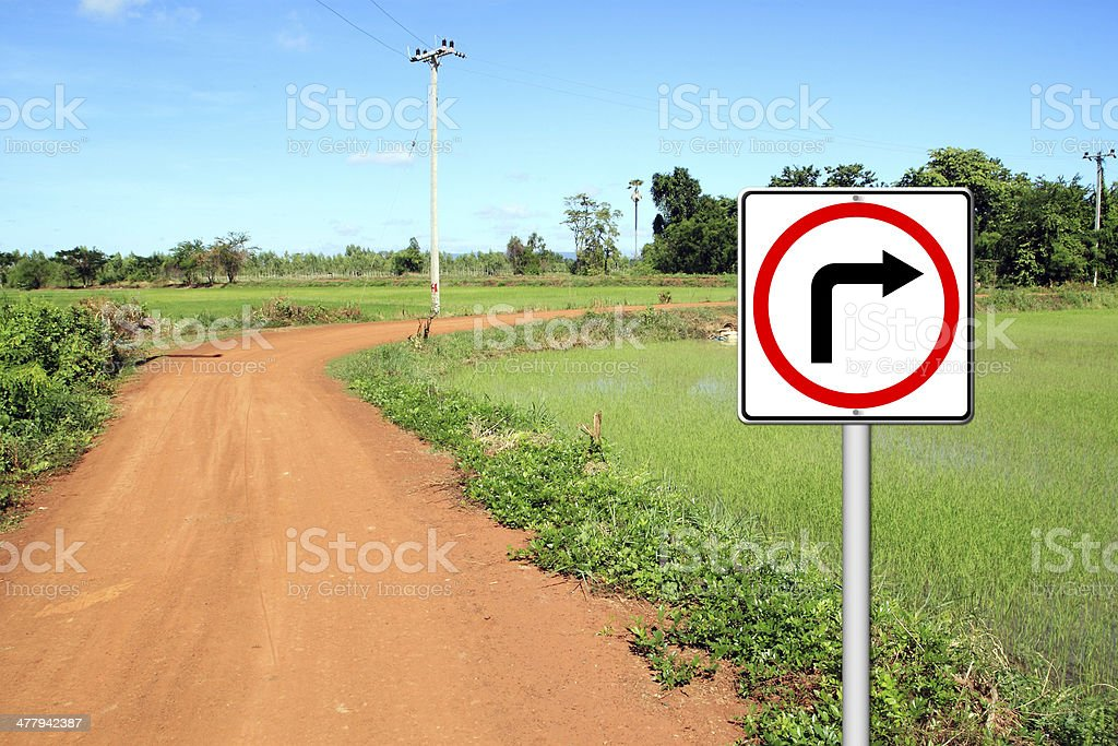 Turn right sign with soil road royalty-free stock photo