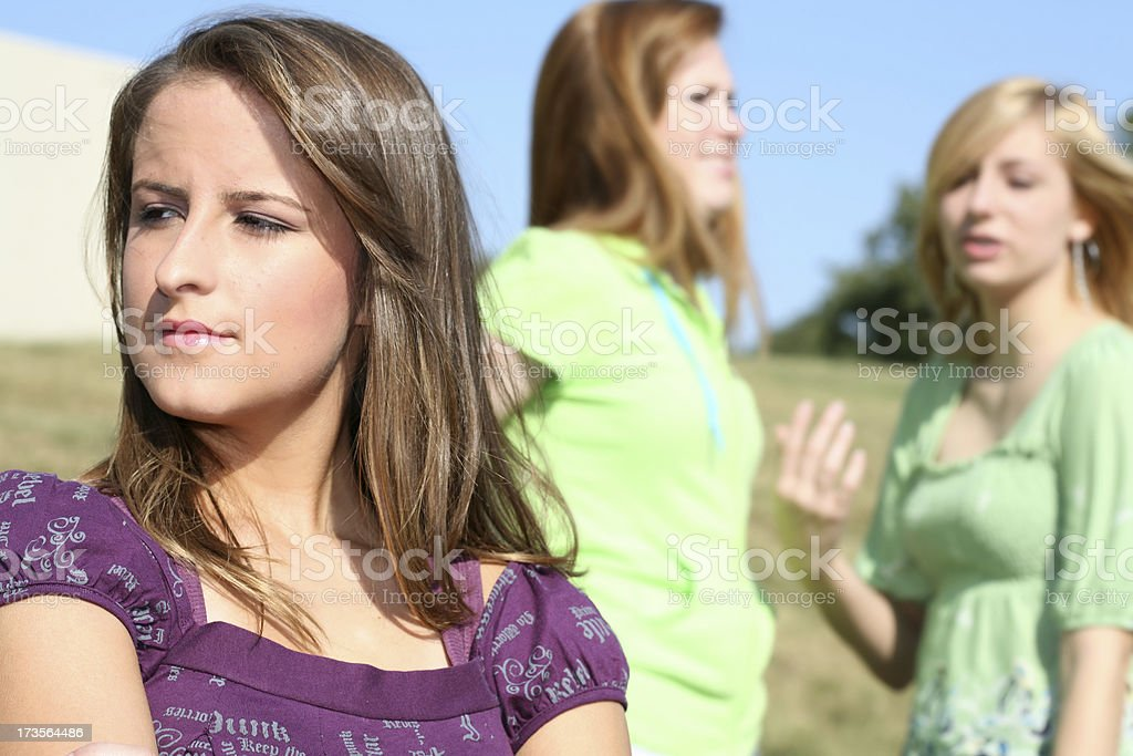Turned Away from Friends royalty-free stock photo