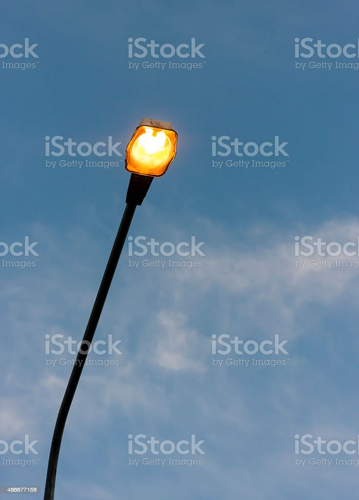 Turned on streetlight in the eveing stock photo