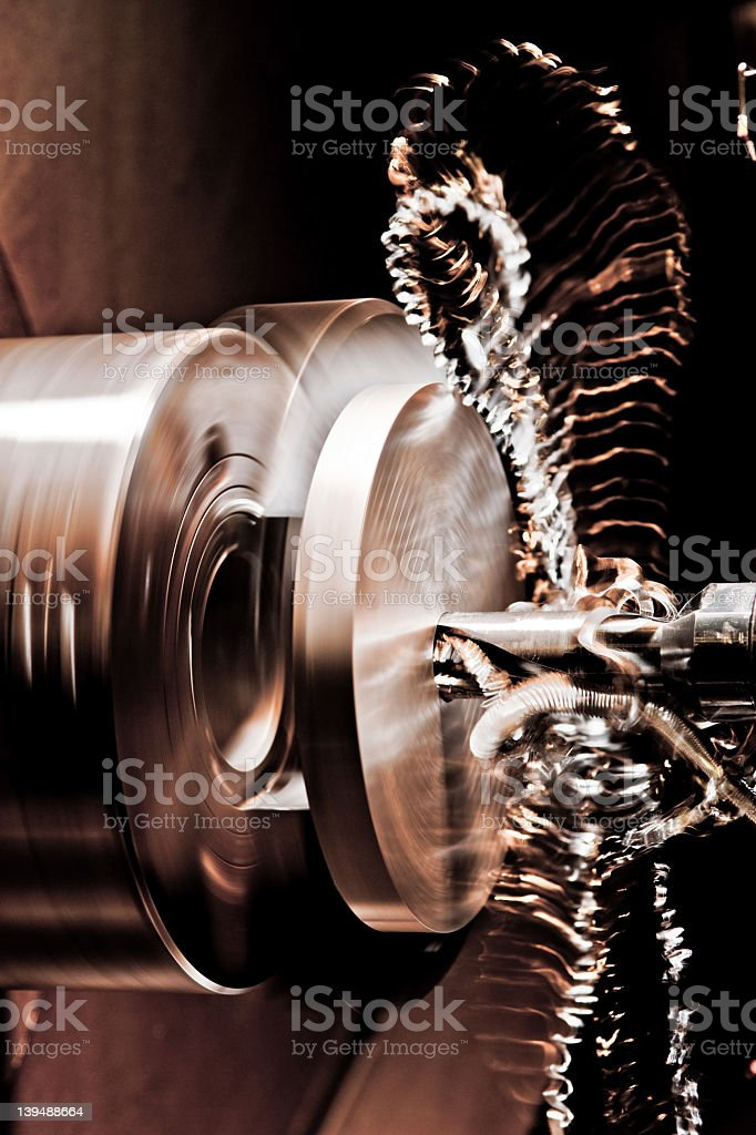 Turned part is clamped in a lathe stock photo