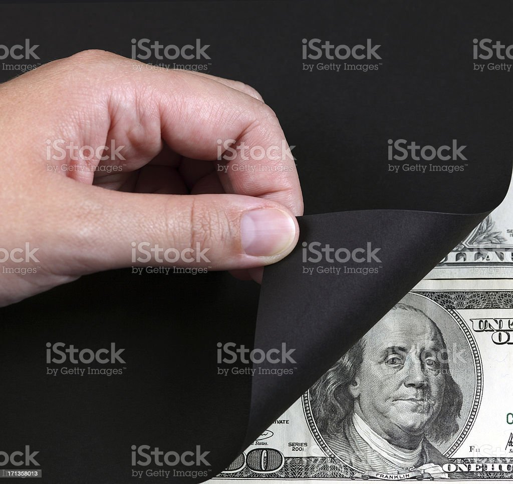 Turning black page and money royalty-free stock photo
