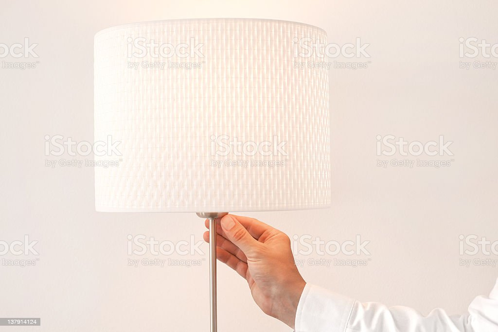Turning lamp on stock photo