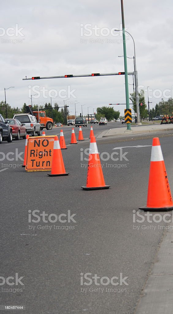 turning lane closed 'no right turn' allowed pylons up stock photo