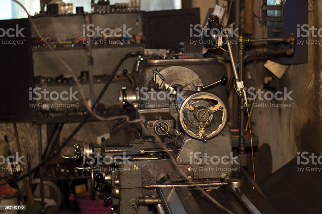 Turning lathe in the workshop. Old turning machine workshop.