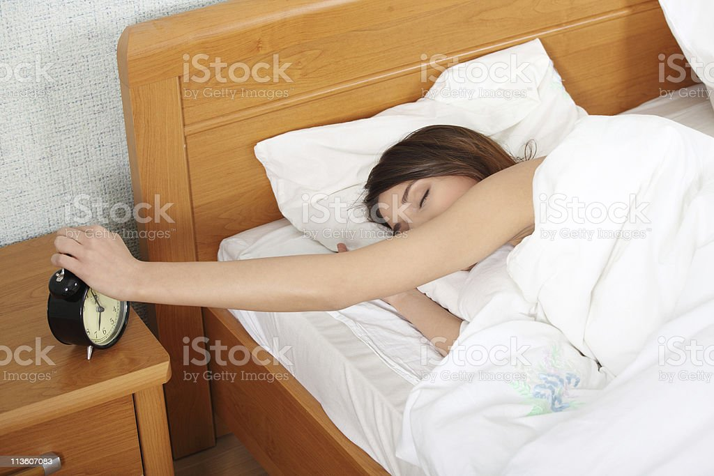 Turning off alarm clock stock photo