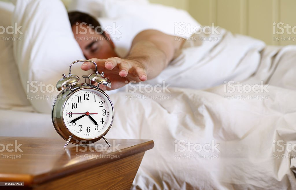 Turning Off Alarm Clock royalty-free stock photo