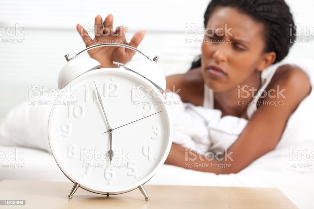 Turning off alarm clock. stock photo