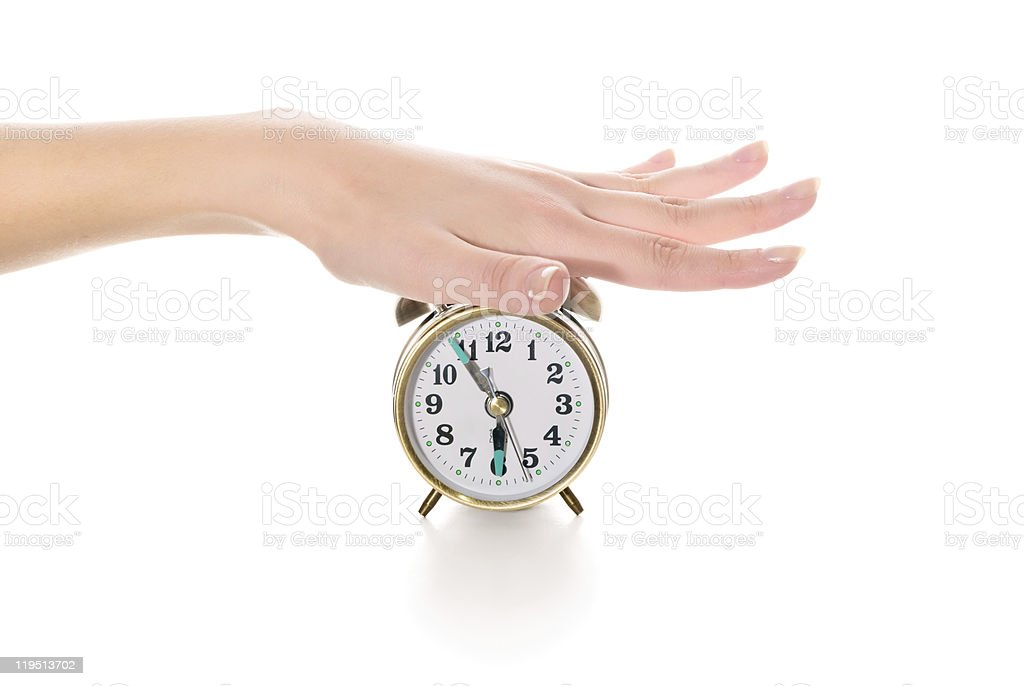 turning off the alarm clock royalty-free stock photo