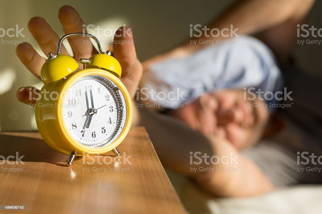 Turning Off The Alarm stock photo