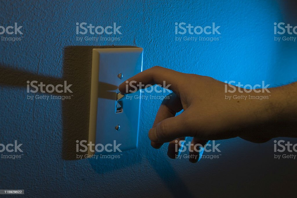 Turning off the lights with finger stock photo