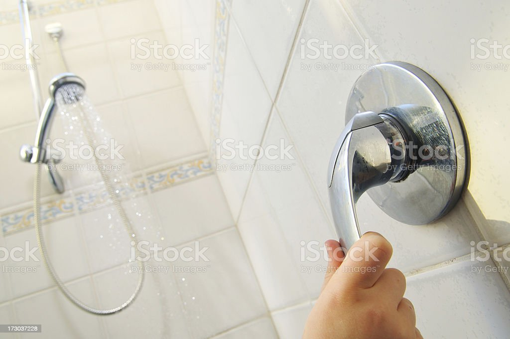 Turning off the shower royalty-free stock photo
