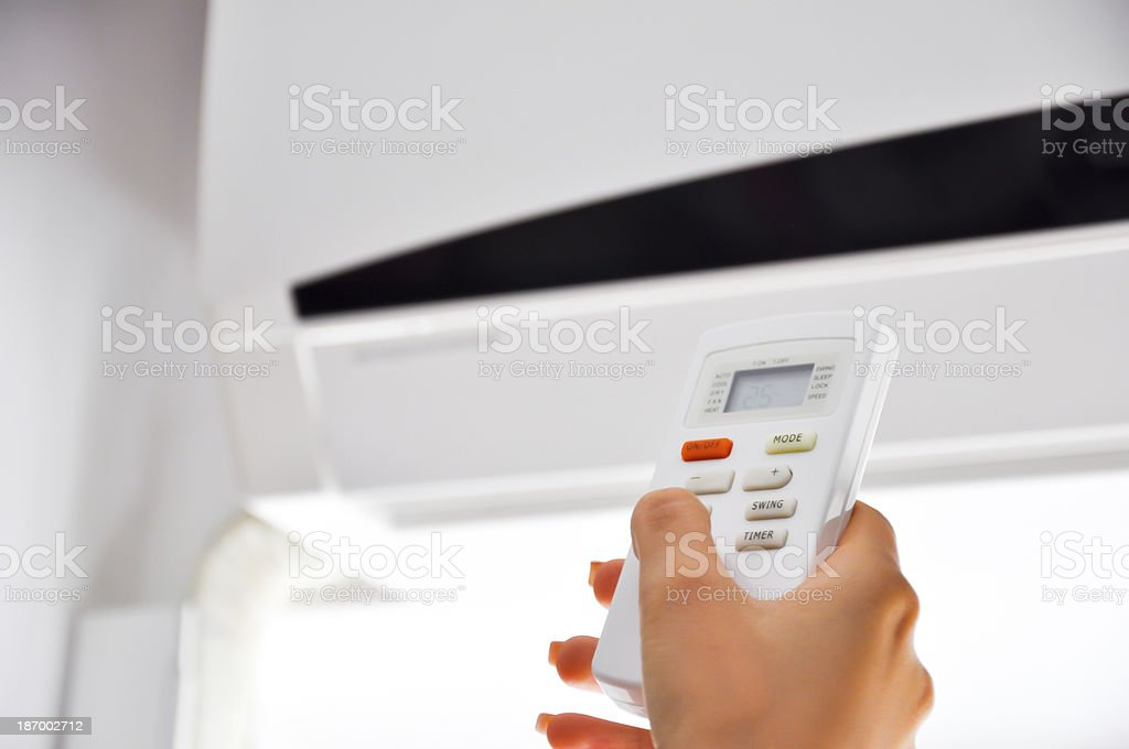 turning on air conditioner stock photo