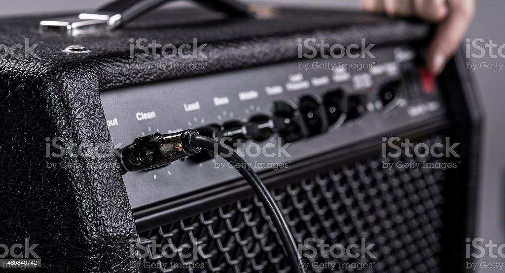 Turning on amplifier stock photo