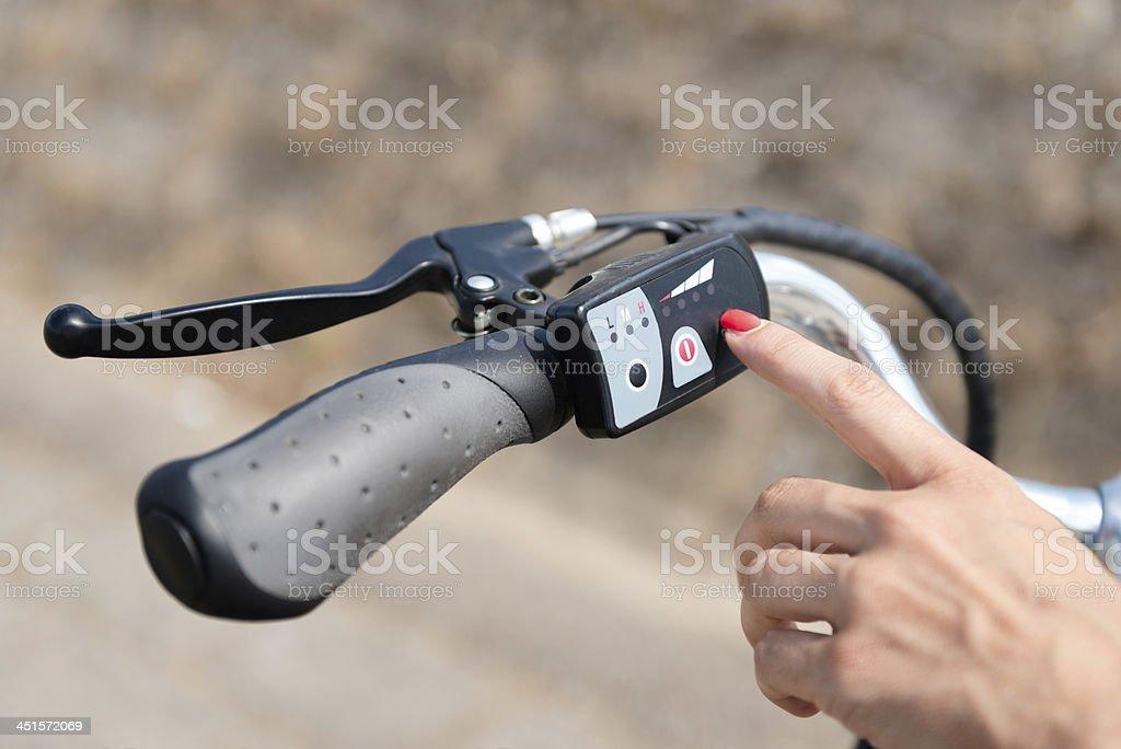 Turning on electric bike stock photo