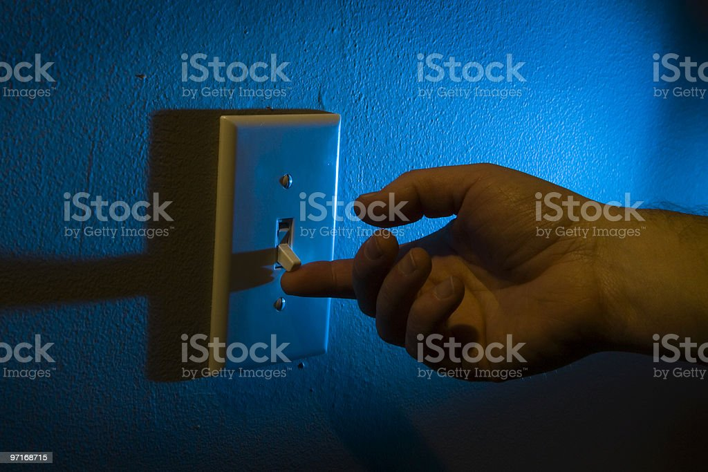 Turning on the light switch stock photo