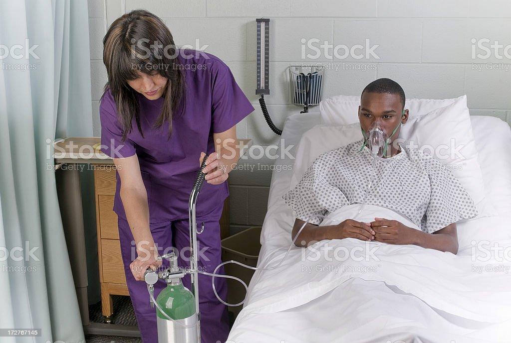 Turning on the oxygen tank stock photo