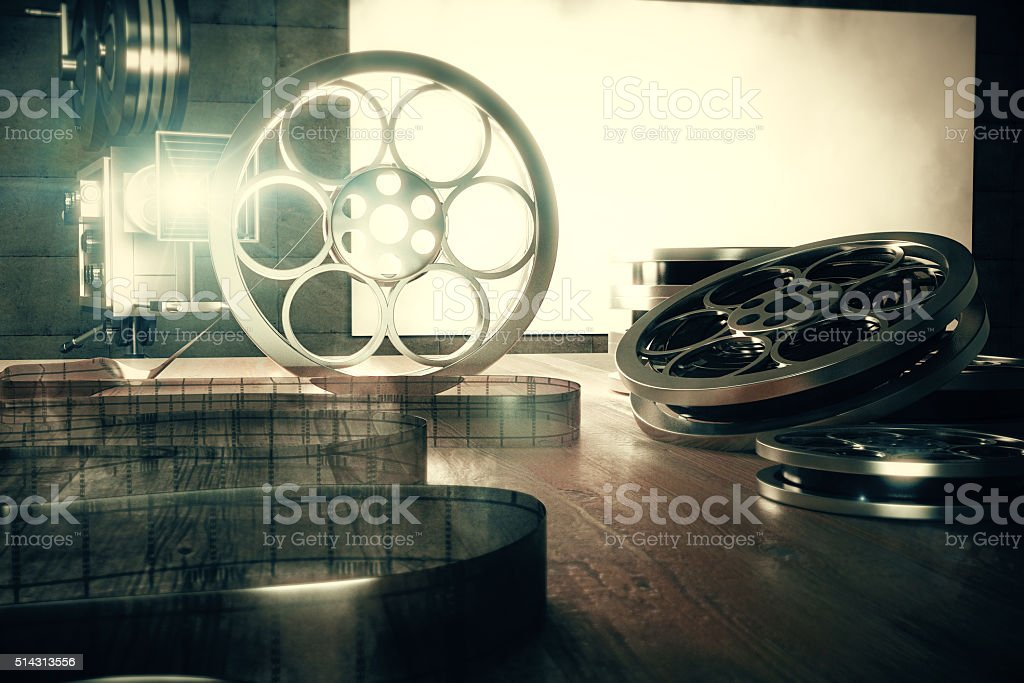 Turning on vintage film camera with old style film cartridges stock photo