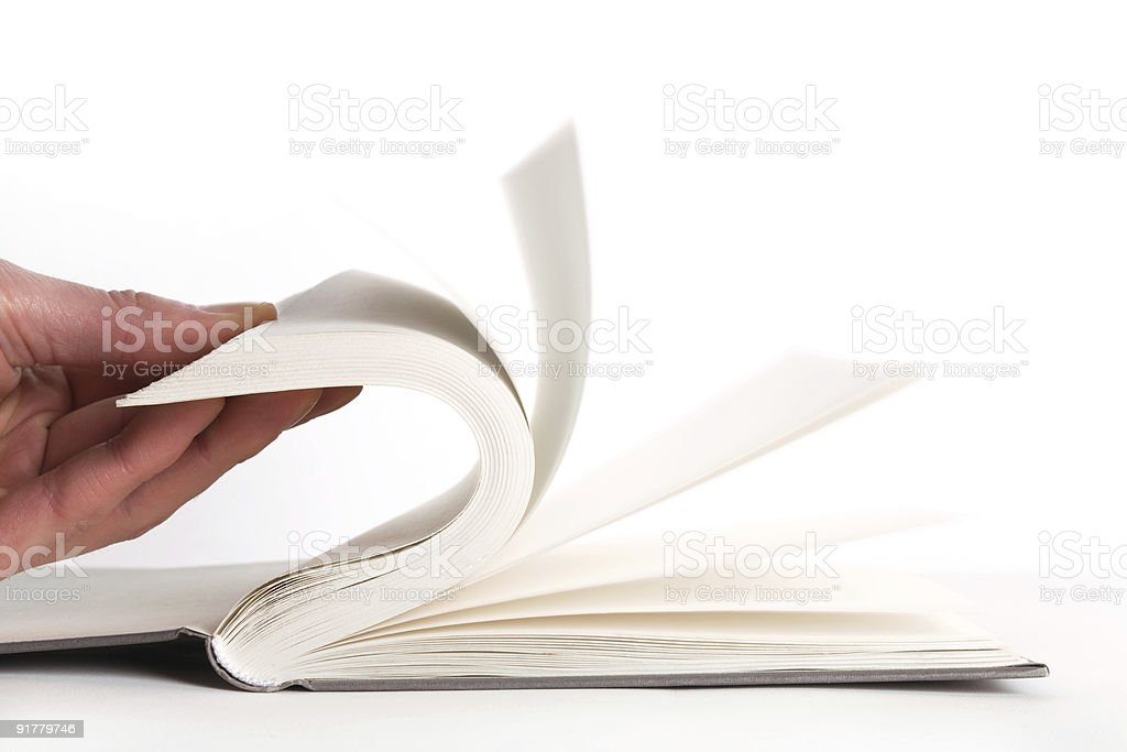 Turning pages of an empty white hardcover book royalty-free stock photo