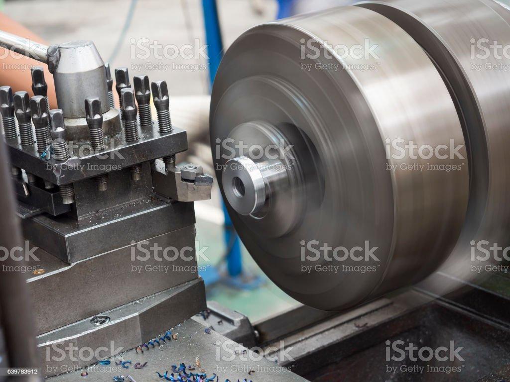turning part by manual lathe machine stock photo